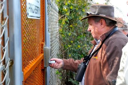 Tom tries to jimmy gate lock (KB)